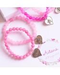 6 pulseras de cuarzo rosa con corazón grabado